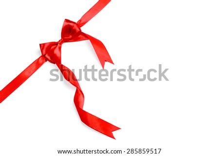 Red ribbons with bow with tails isolated on white background - stock photo