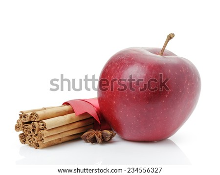 red ripe apple and cinnamon sticks, isolated on white - stock photo