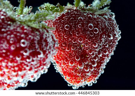 Red ripe strawberries with water bubbles, closeup - stock photo
