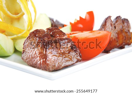 red roast meat served on white dish - stock photo