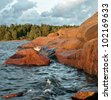 Red rock at sunset - Aland Islands, Finland - stock photo