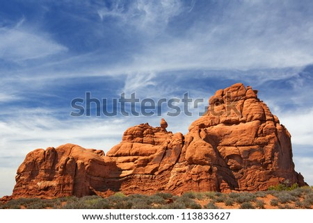 Red Rock Formations in Arches National Park with dramatic Blue Sky - stock photo