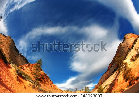 Red rock mountain scene with blue sky and clouds in Zion National Park with fisheye - stock photo