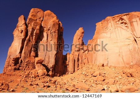 Red rocks against deep blue morning sky in Monument Valley, Navajo Nation, Utah - stock photo