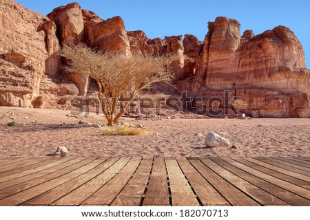 Red rocks desert landscape with wooden floor background. Timna national geological park (Israel).  - stock photo