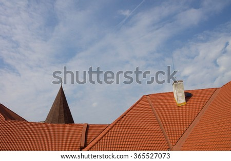 Red roof and blue sky big house - stock photo