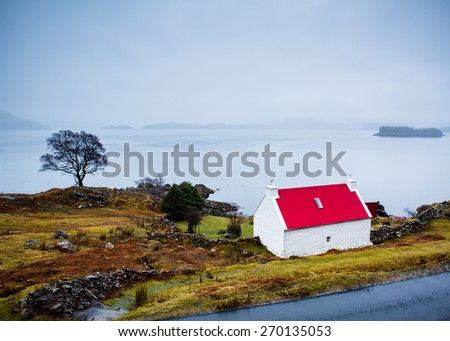 Red-Roof of an isolated house in teh highlands - stock photo
