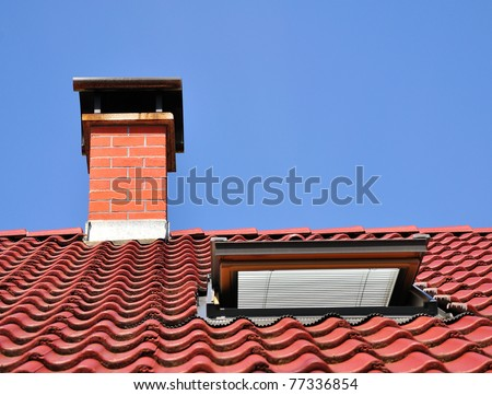Red roof with chimney made from tiles and one dormer. - stock photo