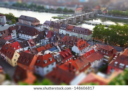 Red roofs of town of Wurzburg. Pseudo tilt shift effect. Germany - stock photo