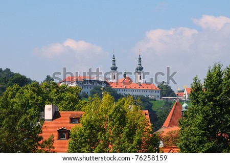 Red roofs with two church towers in the behind - stock photo