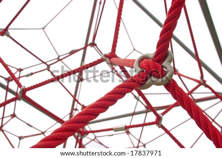 Red rope structure on white background - stock photo
