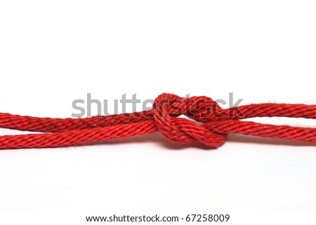 Red rope with a knot isolated on white - stock photo