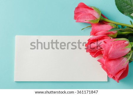red rose and blank gift card for text on paper background - stock photo