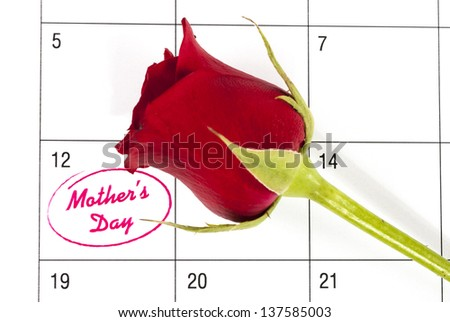 Red rose bud on calendar showing mothers day - stock photo