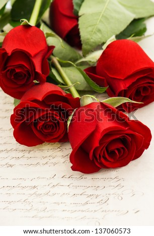 red rose flowers and old love letters. romantic vintage style background. selective focus - stock photo
