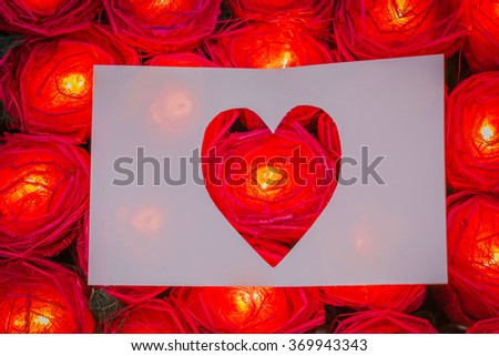 Red rose light  with heart paper - stock photo