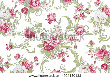 red rose on white fabric background, Fragment of colorful retro tapestry textile pattern with floral ornament useful as background. - stock photo