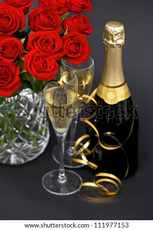 red roses and champagne. festive decoration. romantic arrangement. selective focus - stock photo