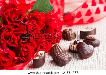 red roses  and chocolate candies for Valentine's Day - stock photo