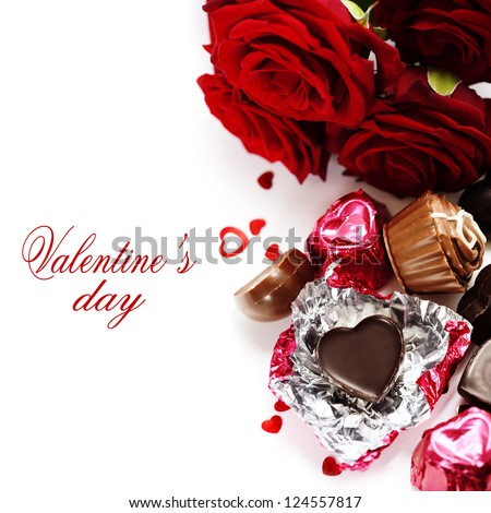 red roses  and chocolate hearts for Valentine's Day (with sample text) - stock photo
