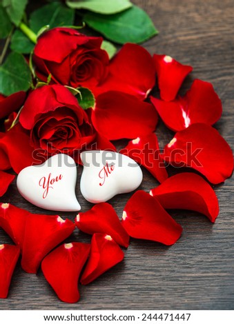 Red roses and two hearts. Valentines Day decoration. Sample text You Me - stock photo