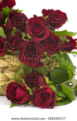 red roses in a basket - stock photo