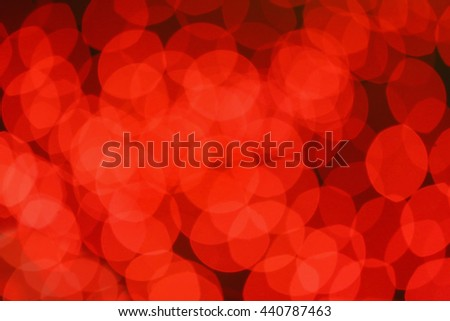 red round abstract spots of light against dark background - stock photo