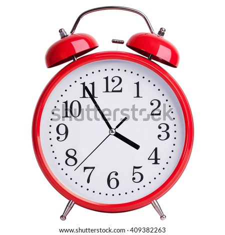 Red round alarm clock shows five minutes to four - stock photo