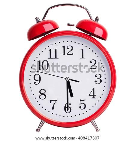 Red round alarm clock shows half past five - stock photo