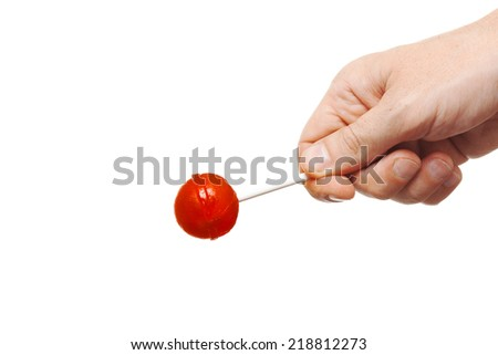 red round candy in hand isolated on white - stock photo