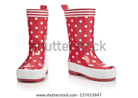 Red rubber boots for kids isolated on white background - stock photo