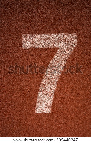 Red running track lane number 7 - stock photo