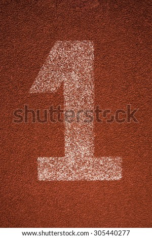Red running track lane number 1 - stock photo