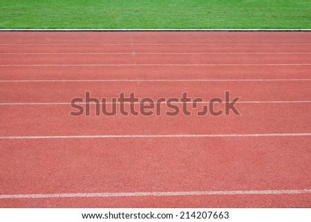 Red Running Tracks Background - stock photo