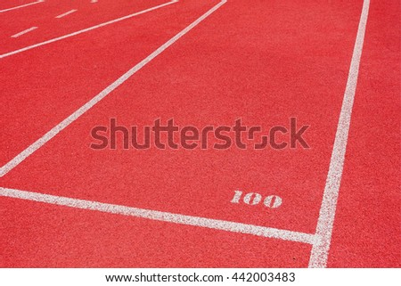 Red running tracks white lines separated in stadium for competition or business concept - stock photo