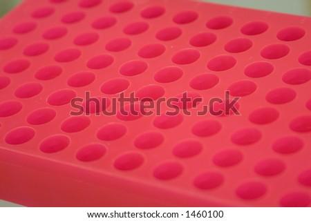 Red sample tube rack - stock photo