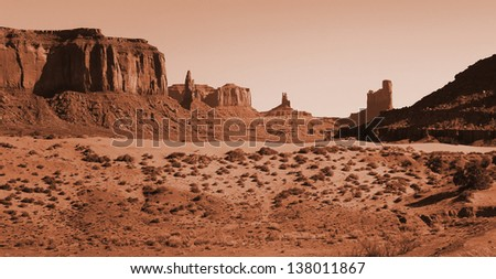 Red sand dunes and mitten at Monument valley, Arizona - stock photo