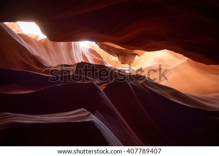 Red sand rock eroded by water and wind inside mountain cave, antelope canyon, Arizona, USA - stock photo