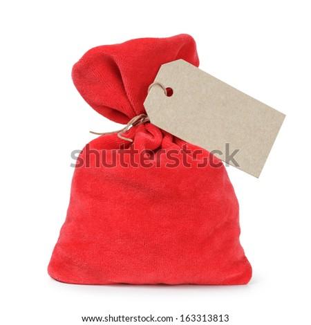 red santas bag from velvet fabric, isolated on white - stock photo