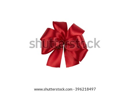 Red satin bow flower shaped in the center of picture. Isolated on white. With clipping path. - stock photo