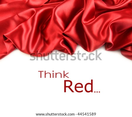 Red satin fabric against white background - stock photo