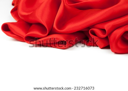 Red satin fabric against white background. studio shot - stock photo