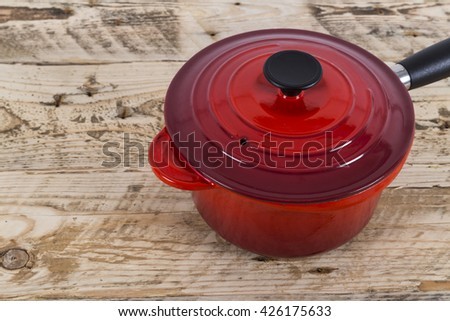 Red saucepan with lid - stock photo