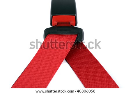 Red seat belt clasped on the lock isolated on the white background - stock photo