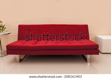 red seat decorated in pink room - stock photo