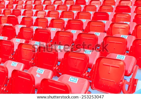 Red seat in the stadium. - stock photo