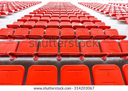 red seat - stadium row group nobody section sport arena - stock photo