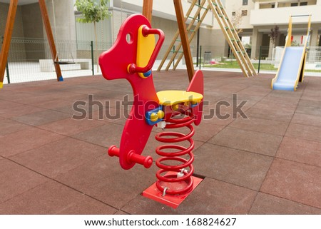 Red Seesaw in Playground inside buildings - stock photo