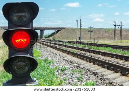 red semaphore near railroad - stock photo