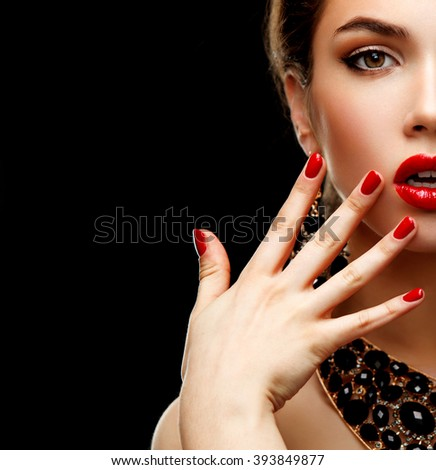 Red Sexy Lips and Nails closeup. Open Mouth. Manicure and Makeup. Make up concept. Half of Beauty model girl's face isolated on black background  - stock photo